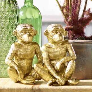 AFFENPÄRCHEN sitzend goldfarben H 14 cm
